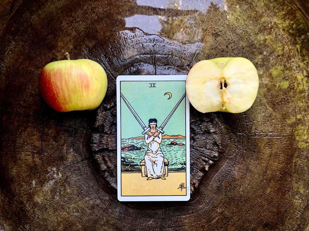 tarot cards, tarot magic, tarot spells, two of swords, libra magic, libra spells, spells for libra season, justice magic, pittsburgh tarot readers, professional tarot readers,